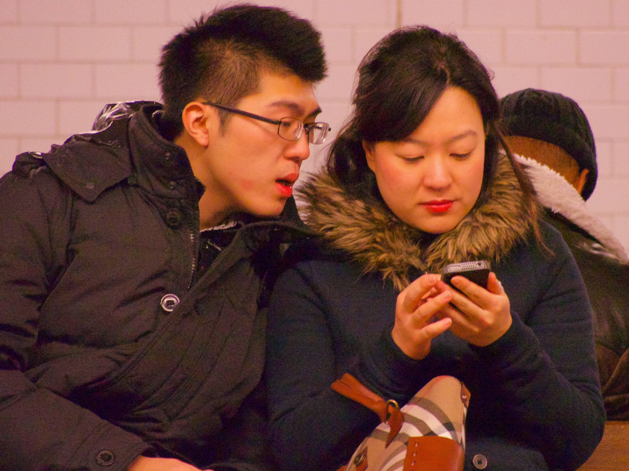 Smartphones in public, transgressing personal space. Photo by Ed Yourdon.