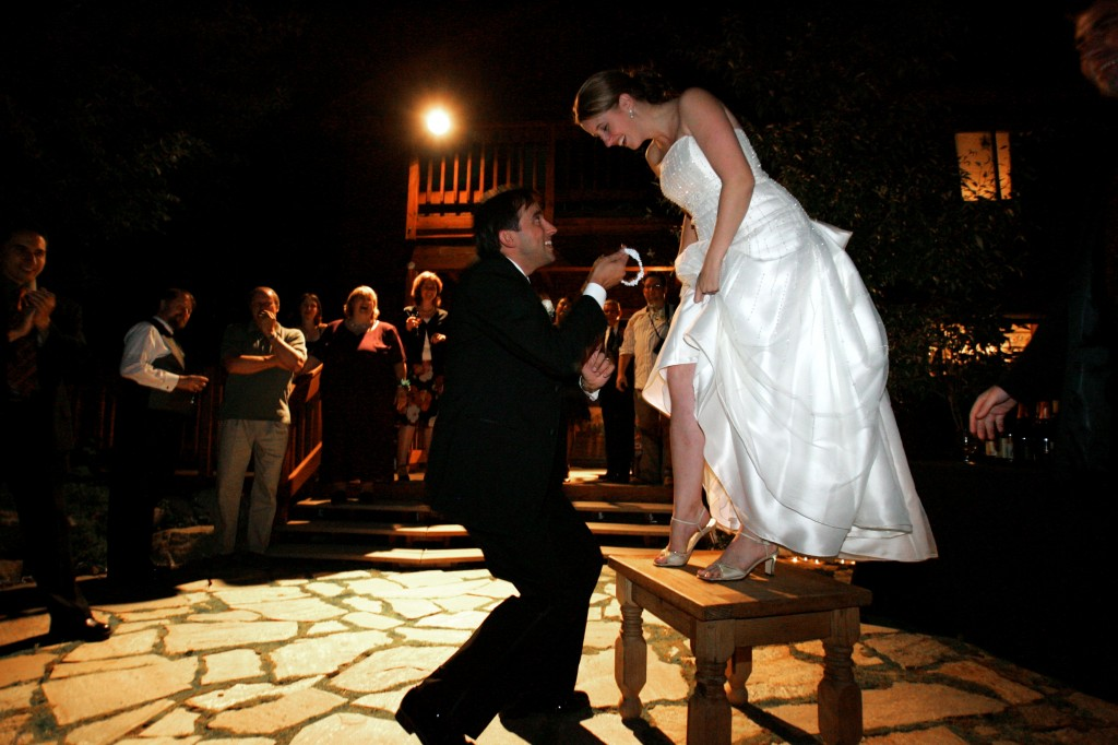 A traditional garter toss at a wedding. Image by Brandon and Kaja Geary on Flickr, CC BY-ND.
