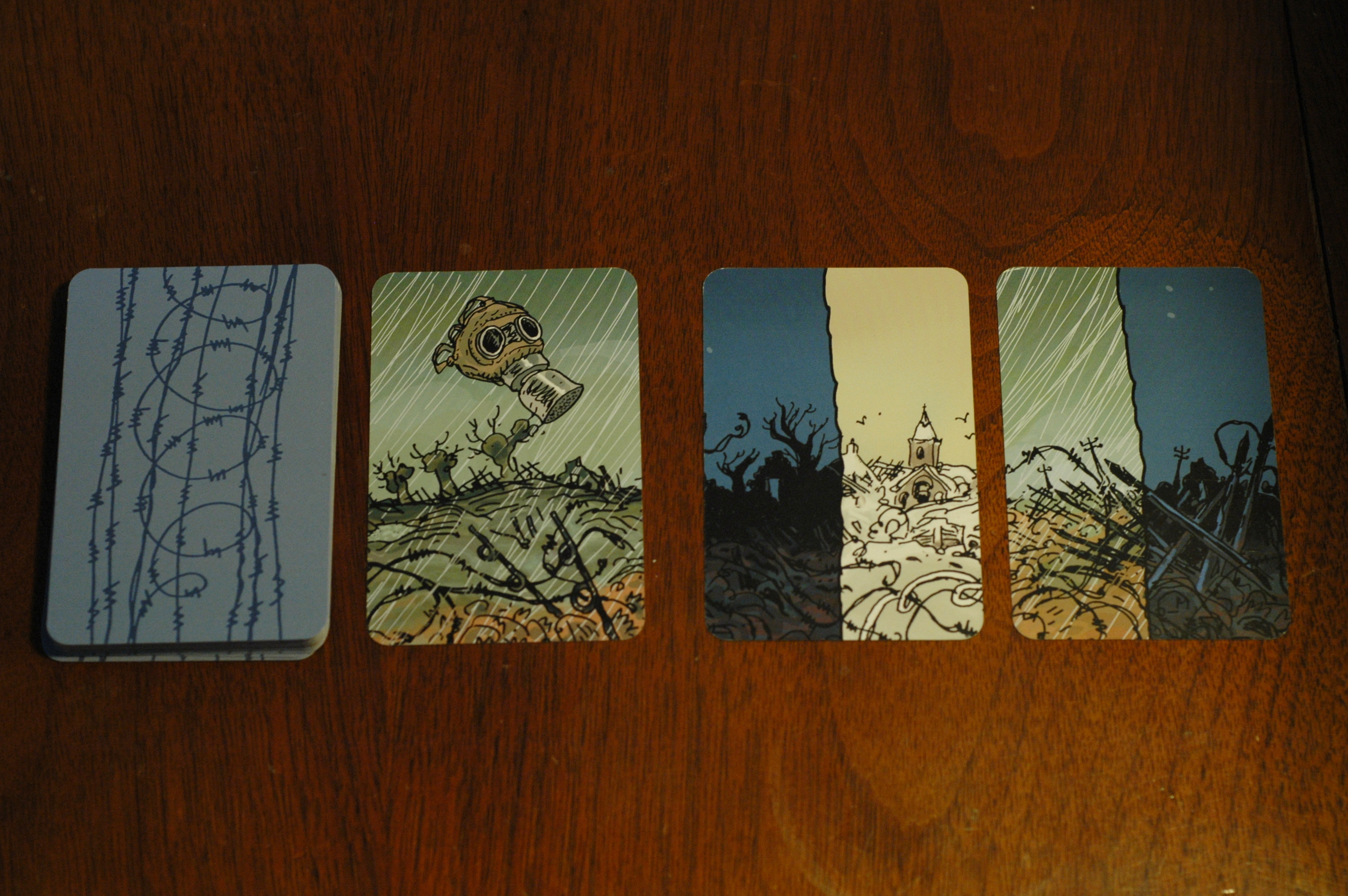 There are two night, two rain, one snow, and one gas mask symbols in this sample tableau (the deck is to the far left). If the players play another card with night or rain into the tableau, they will fail the mission. Photo used with permission of the author and used for purposes of critique.