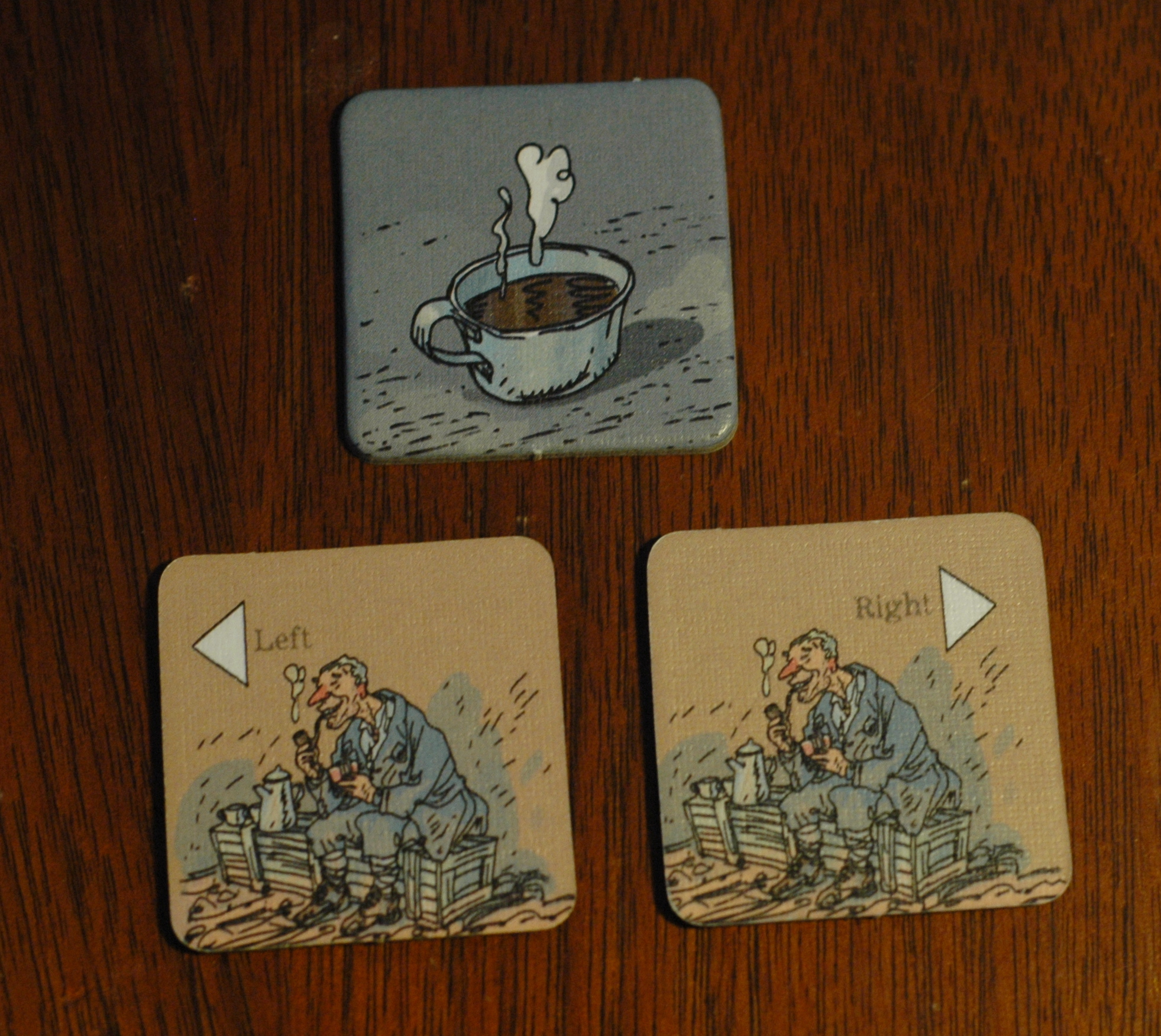 Players assign support facedown (coffee side up), then reveal one arrow. Double-left and double-right tiles also exist. Photo used with permission of the author and used for purposes of critique.