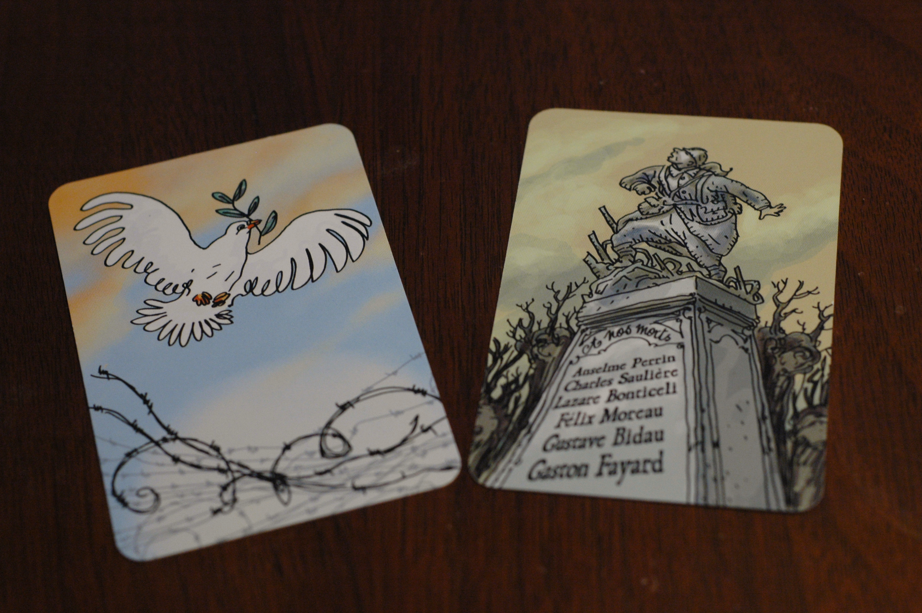 Revealing the Monument card (right) ends the game in a loss. If the Peace card is revealed, all players must empty their hands before the game is won. Photo used with permission of the author and used for purposes of critique.