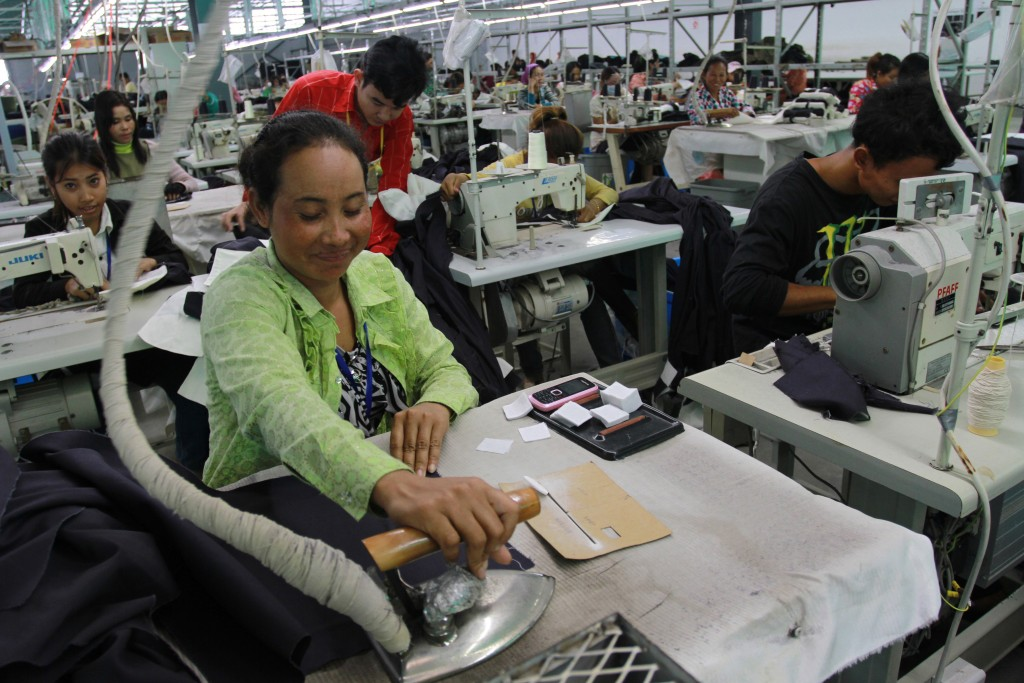 Victory in Loy Loy means buying and owning the community garment factory. Image by the World Bank Photo Collection CC BY-NC-ND.