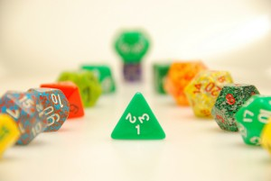 "As a character progresses in levels, sometimes dice rolls become seemingly unnecessary as her ability score modifiers might guarantee her success. Image ""Dice"" by Chris Yarzab @Flickr CC BY-NC-ND"