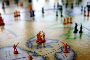 This is an image of a Risk player board with plastic game pieces on the map.