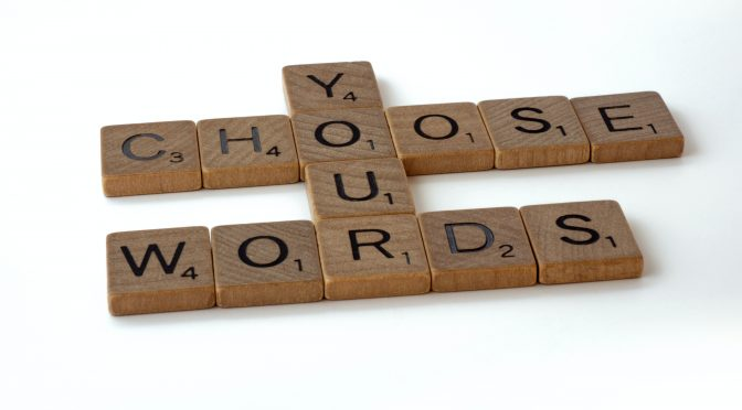 This is a set of Scrabble tiles that spells out Choose Your Words. Photo by Brett Jordan on Unsplash