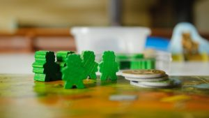 This is a group of green meeples on a board game board.