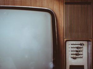 This is an image of a retro television in a wooden cabinet